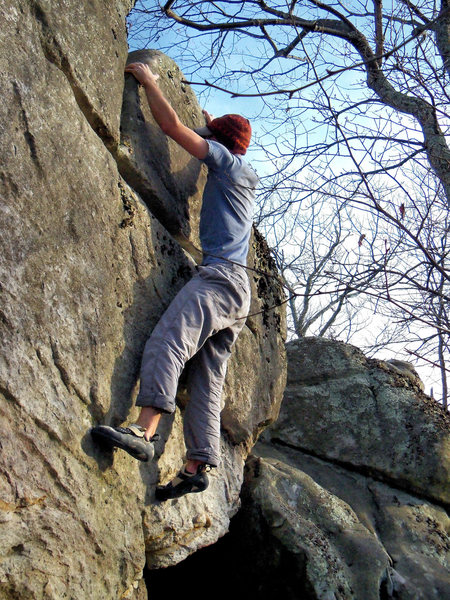 """Aaron Parlier with the fa of """"Domain"""" (V-4). Maxima Boulder. Bluefield."""