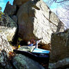 "Aaron Parlier on ""Maxima"" (V-5-6). Maxima Boulder. Bluefield."