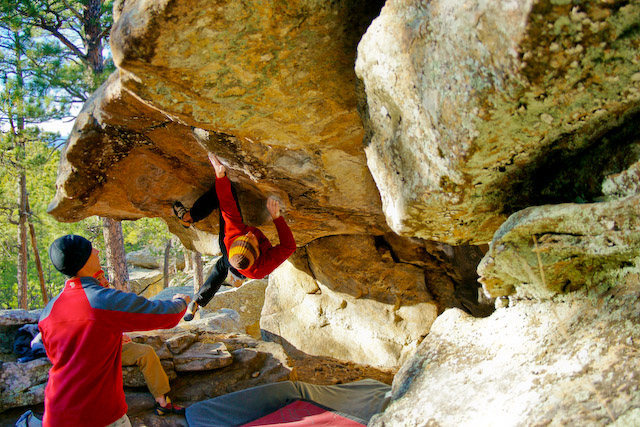 climbing one of the many routes in the cave