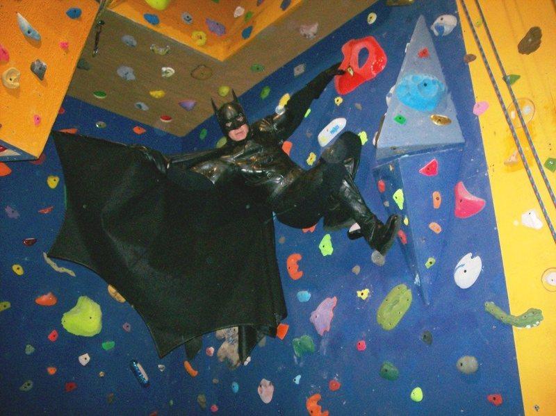Batman unfurls the wing for his next move.