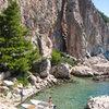 Cliffbase on the island of Hvar.  Miroslav in his boat.