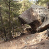 This is the boulder that overhangs the trail to the Gully areas and is visible from the parking spot.