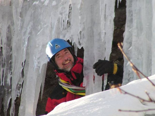 Peering out from behind the last pitch's ice curtain.<br> Photo by Maurice Corrigan.