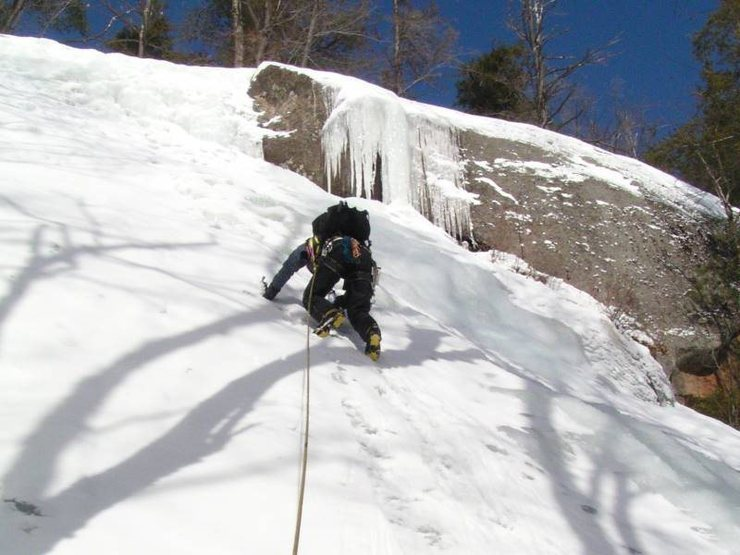 Maurice Corrigan sets out on P1 of the <em>Waterfall</em> on Crane Mtn's SE slope.