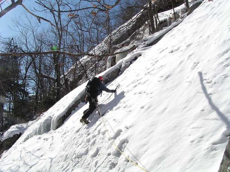 Maurice Corrigan leads out on P5 of the <em>Waterfall</em> ice route.