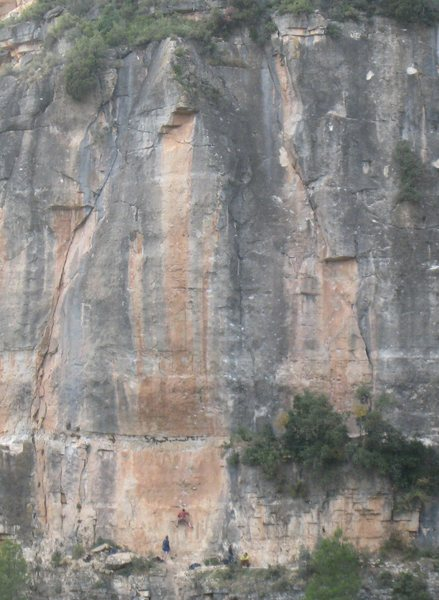 Markus starting up the towering line.  The route climbs the right side of the orange streak, weaving in and out onto the gray streak to the right, to finish just below the high triangular roof.
