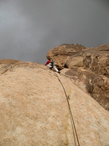Passing the third bolt on McStain (5.8), Joshua Tree NP <br>