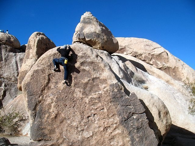 James topping out on Try-Tip Sandwich (V1), Joshua Tree NP