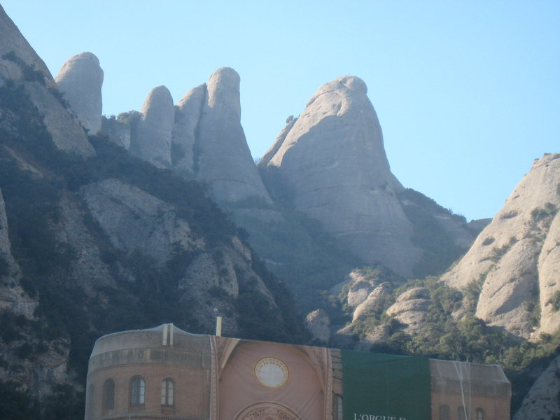 Rock Climbing Photo: The Gorros sit high above the Monastery square.