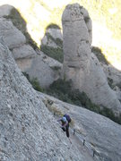 Rock Climbing Photo: Pitch 1, with El Trencabarrals in the background. ...