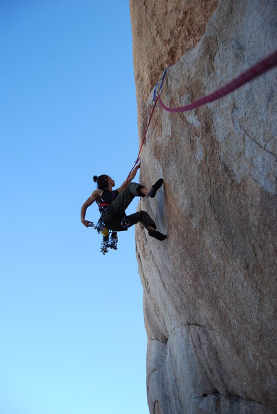 Chalking up before the crux move.