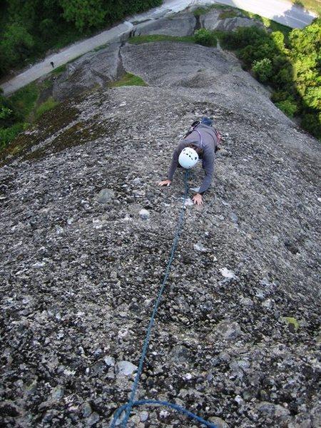 Climbing pitch two of Ostkante.