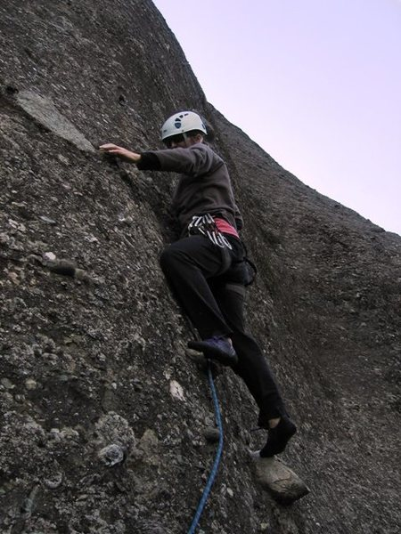 Stepping up for the crux of Ostkante on pitch 4.