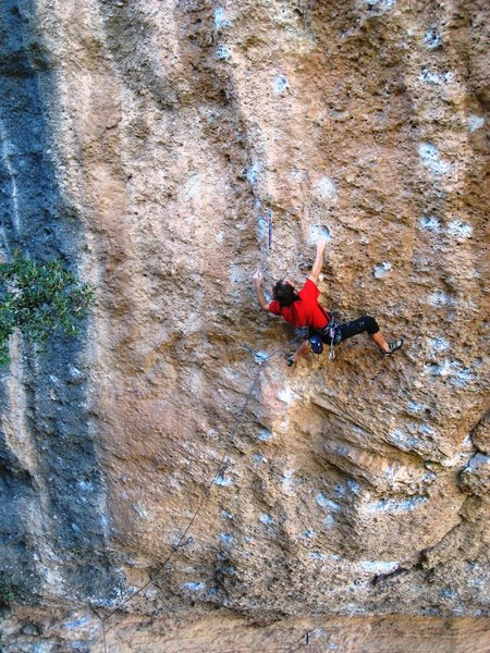 Enjoying the beautiful cobblestone of Margalef, on Magic Line, 7c.