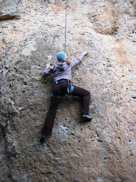 The crux start of Perepunyetes.  Start way left for 5.10.  Going up directly below the bolt is ~5.11c.