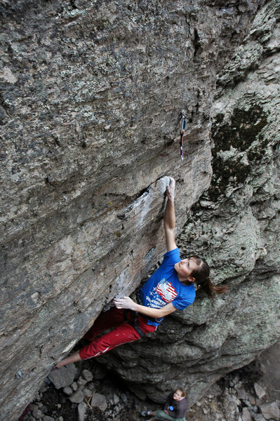 Fun big moves on jugs turn the lip of the overhang before the technical arete.