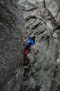 Rock Climbing Photo: Searching for holds on the thin arete that guards ...