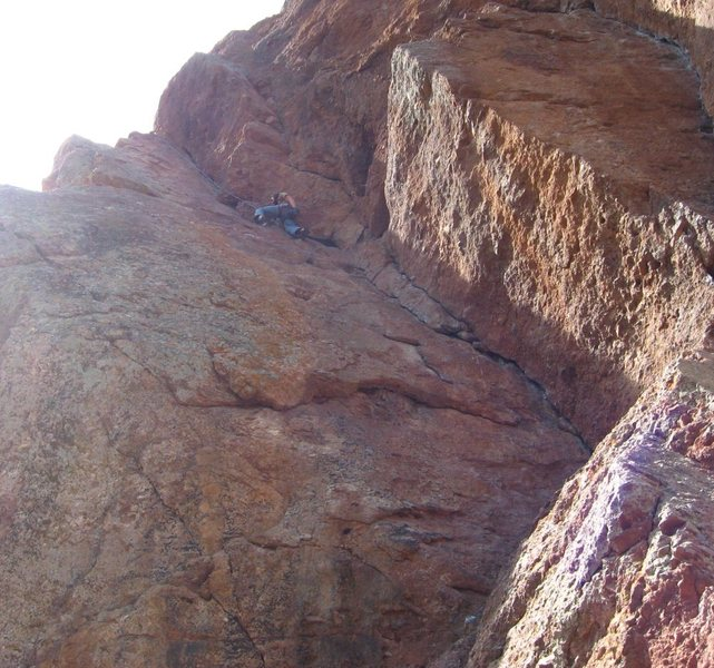 Trans taking a moment to chalk up about halfway up Swallow Crack.