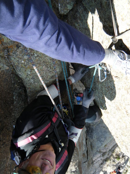 Randy Harris taking a photo down through roof at belay. Belayer, Douglas Lossner. Artemis Vendemmia climbing.