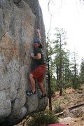 Rock Climbing Photo: The crux lock off on Problem C