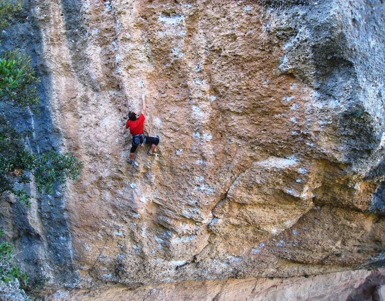 Rock Climbing Photo: A big move up to one of the few 2-finger pockets.