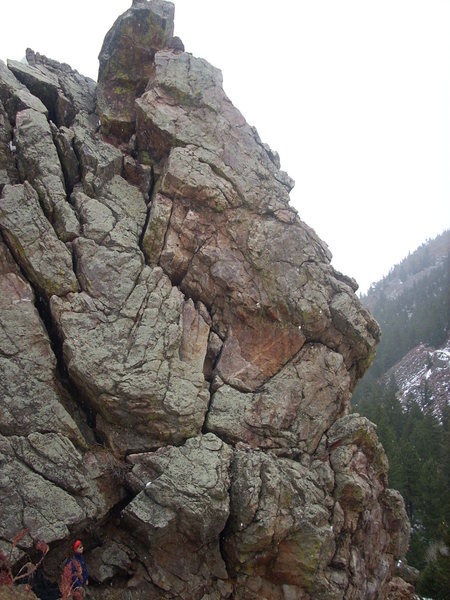 Climb through the bulging crack in the center of the photo.