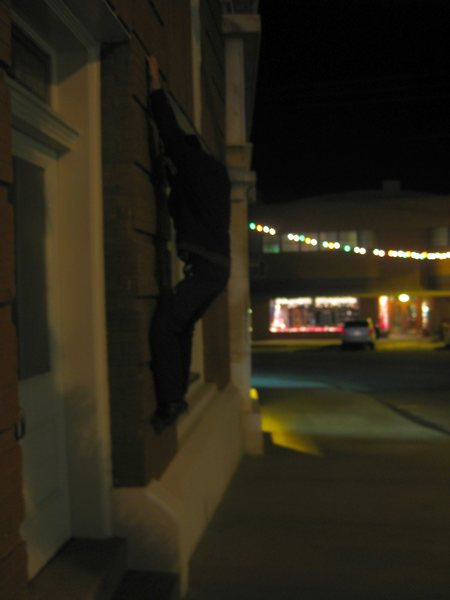 Some man I don't know buildering on a bank somewhere in AZ. late at night. @SEMICOLON@ /