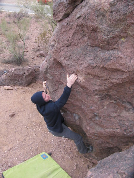Daniel warming up on the arete.