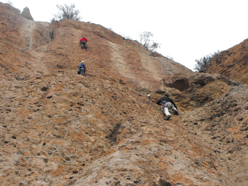 """A busy day at Echo Cliffs with parties of climbers on P2 of """"Harvey"""" (left) and P1 of """"The Serpent"""" (right)."""