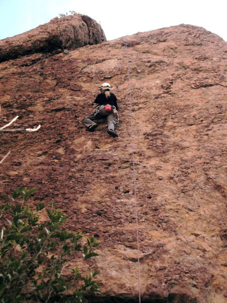 """Pam Neal pulling on the steep fun features on the 1st ascent of """"Intellitoys,"""" in the Test Site."""