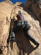 Rock Climbing Photo: Patty susses out the opening moves of Sgt. Saturn.