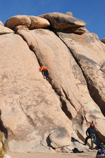 Patty Fienup climbs B-2, on Trashcan Rock, in Joshua Tree