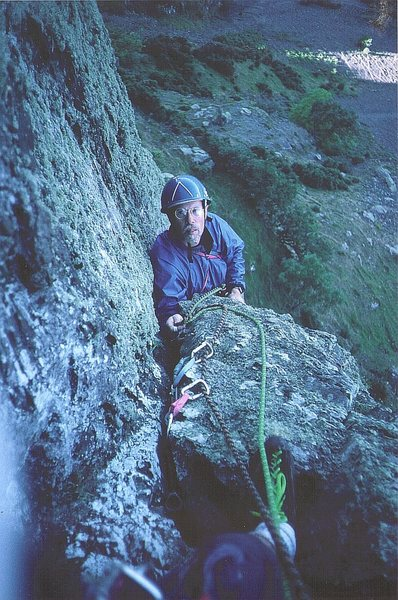 Pete Armstrong arriving at the belay  of the first pitch.FA.1995