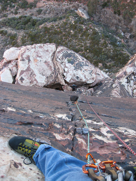 """Looking down at my foot and Derek belaying below, just below the bolt most of the way up the """"last"""" pitch of Cat in the Hat."""