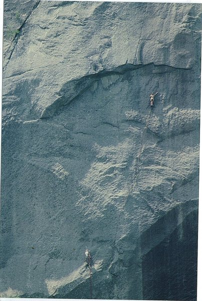 Paul Ross ,Mike Hienz on the First Ascent. Aug 1977. A few minutes after this photo was taken Mike succumbed to heat stroke and had to be lowered semi consious to the ground ..They returned  later to finish the route.