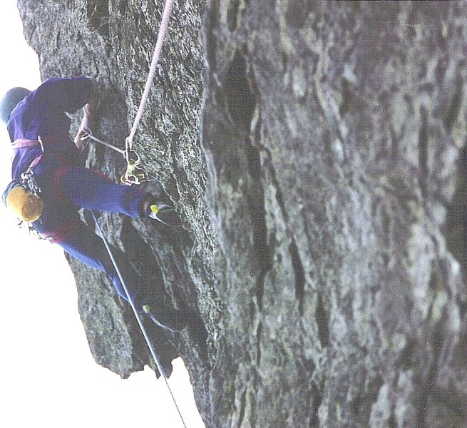 Paul Ross moving onto the exposed arete of the second pitch on the first ascent 1992.