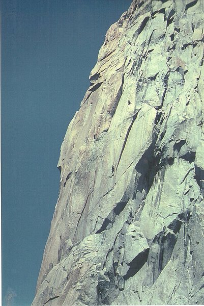 Climbers on the upper section of the Bonatti Pillar.The original route went up the shadow overhang to the right of the climbers.