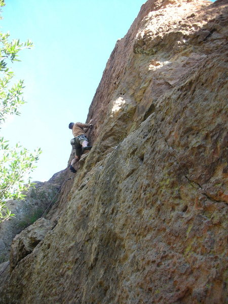 Climber on the upper headwall of Wonder Woman