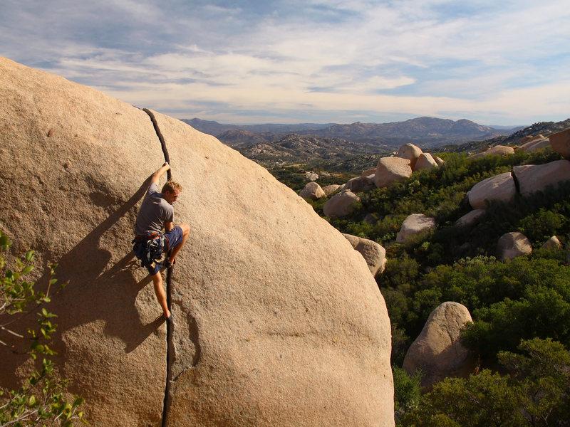 Rock Climbing Photo: Josh warming up on Robbin's Crack.