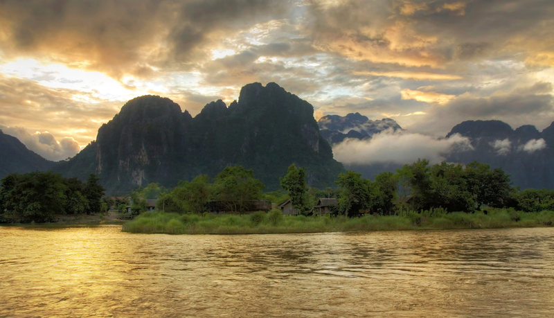 Sunset over the west side of Vang Vieng with the Pha Deang Mountains looming in the background [HDR Composite]
