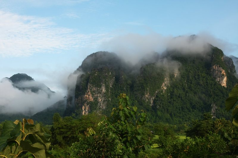 A common sight in Vang Vieng: misty clouds falling across the peaks.