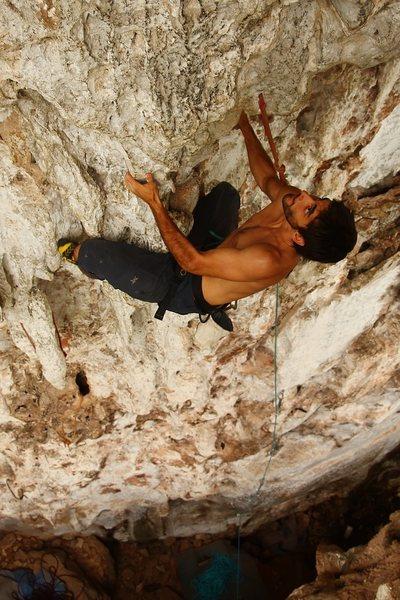 Saul on the finishing bulge - Thanks Josh (5.10d). Vang Vieng, Laos