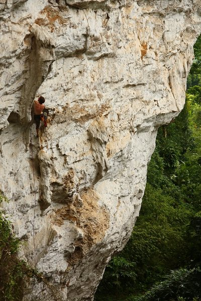 Pier Luigi, getting to the tuffa on Money Can't Buy Me Love (5.11a).  Vang Vieng, Laos.