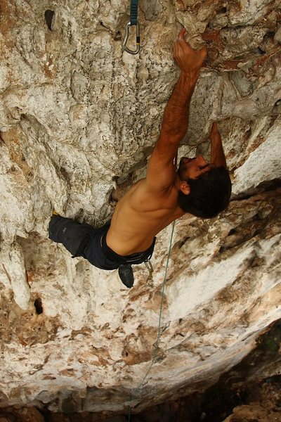 Another of Saul pulling around the bulge on Thanks Josh (5.10d).  Vang Vieng, Laos
