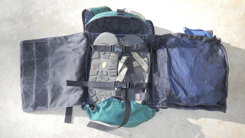 The pack opened up. Footwear in the middle and jacket on the right.