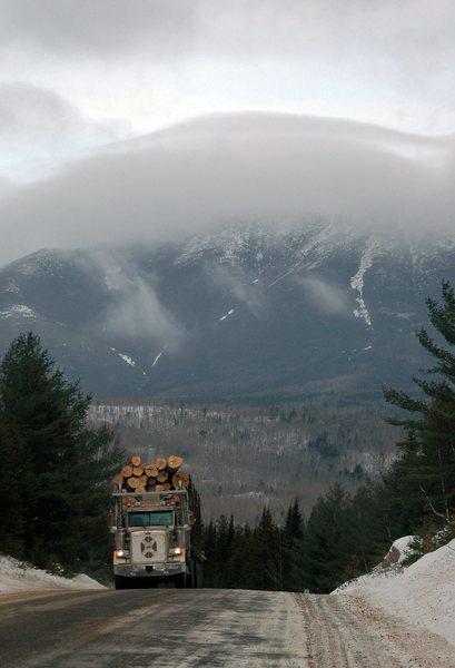 Logging truck and cloud cap over Mt. Katahdin