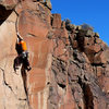 A beautiful crack offers up painful off-fingers in the crux. January 2010.