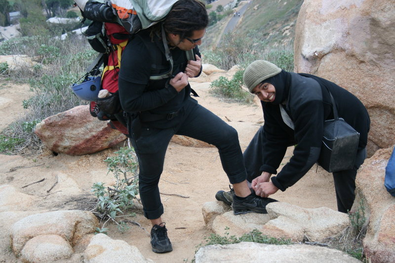 Albert figured the least he could do was tie RastaRaj shoe since he was carrying 2 packs.