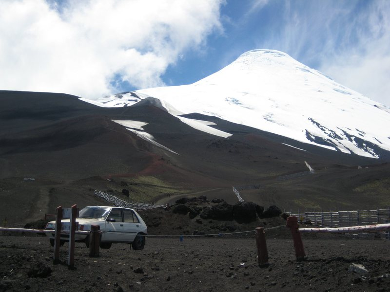 Volcan Osorno from the ski area parking lot, January 2010. The Ruta Normal follows the ridgeline left of the summit.