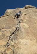 Rock Climbing Photo: Considering the scary and committing move onto the...
